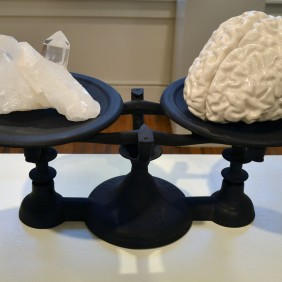 """3 Pounds"" - MRI-rendered slipcast porcelain, quartz, cast iron scale. 16 x 8 x 12"" - 2014."