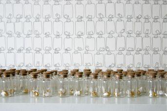 """Tiny Dreams"" - porcelain, gold luster, glass vial, cork - 2.5 x 1"" each - 2013-2015."
